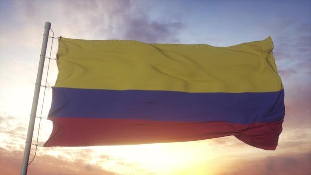 Drapeau de la colombie ondulant dans le fond du vent, du ciel et du soleil. rendu 3d.