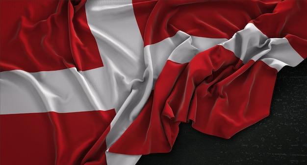 Drapeau danemark enroulé sur fond sombre 3d render