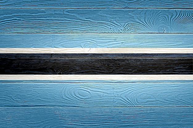 Drapeau du botswana peint sur fond de planche de bois ancien
