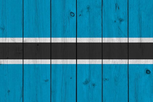 Drapeau du botswana peint sur une vieille planche de bois