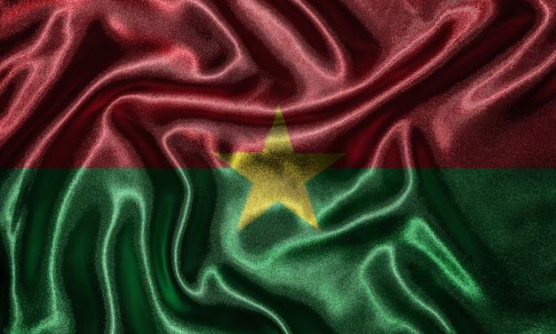 Drapeau du burkina faso - drapeau de tissu du pays du burkina faso, fond d'ondulation.