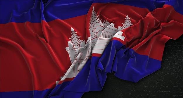 Drapeau du cambodge enroulé sur fond sombre 3d render