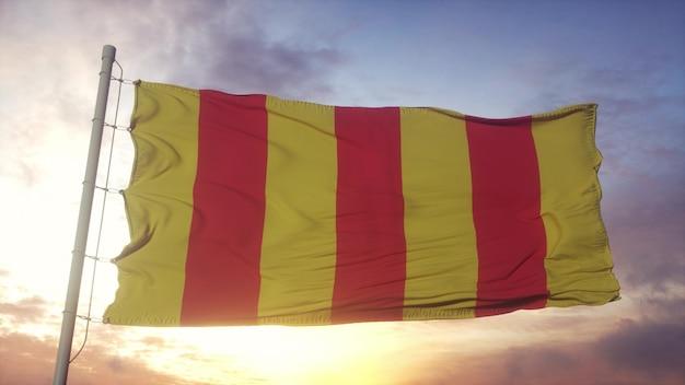 Drapeau du comté de foix, france, ondulant dans le vent, le ciel et le soleil. rendu 3d