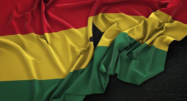 Drapeau du ghana enroulé sur un fond sombre 3d render