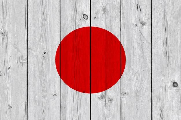 Drapeau du japon peint sur une vieille planche de bois