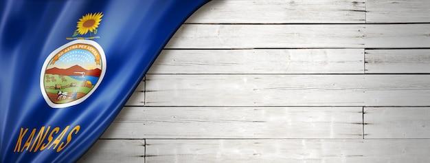 Drapeau du kansas sur fond de bois blanc, usa. illustration 3d