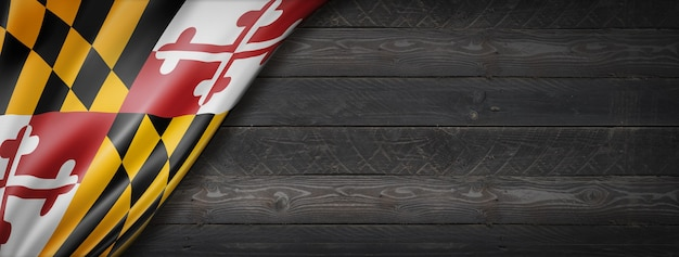 Drapeau du maryland sur la bannière murale en bois noir, usa. illustration 3d