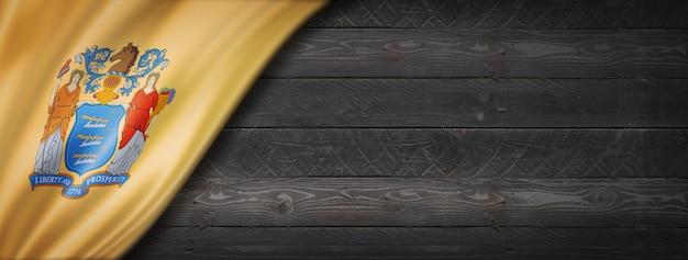 Drapeau du new jersey sur la bannière murale en bois noir, usa