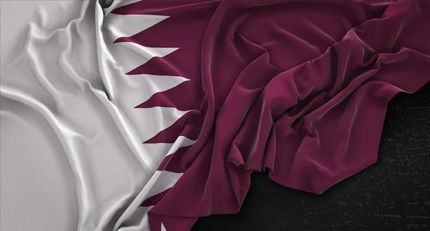 Drapeau du qatar enroulé sur fond sombre rendu 3d