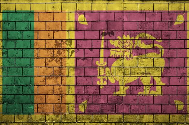 Le drapeau du sri lanka est peint sur un vieux mur de briques