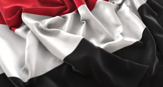 Drapeau du yémen ruffled magnifiquement waving macro plan rapproché