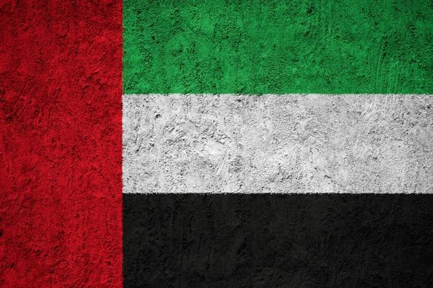 Drapeau des émirats arabes unis peint sur le mur de grunge