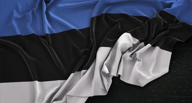 Drapeau estonie enroulé sur fond sombre 3d rendre