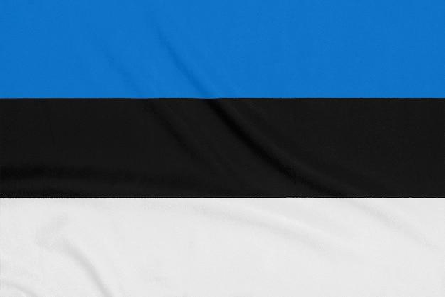 Drapeau de l'estonie sur tissu texturé. symbole patriotique