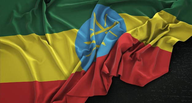 Drapeau de l'éthiopie enroulé sur fond sombre 3d render