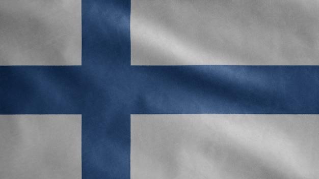 Drapeau finlandais sur le vent. gros plan de la bannière de la finlande soufflant, soie douce et lisse.