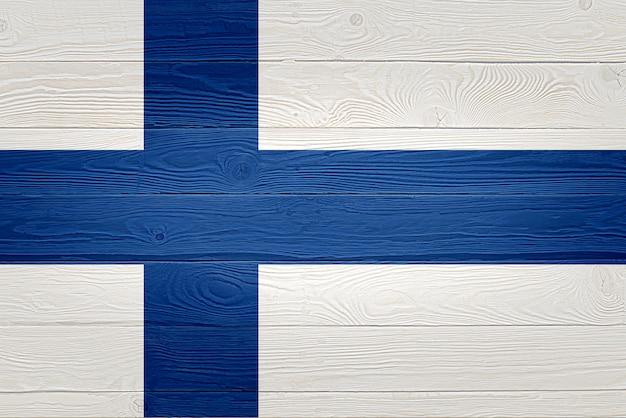 Drapeau de la finlande peint sur fond de planche de bois ancien