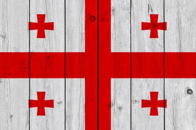Drapeau de la géorgie peint sur une vieille planche de bois