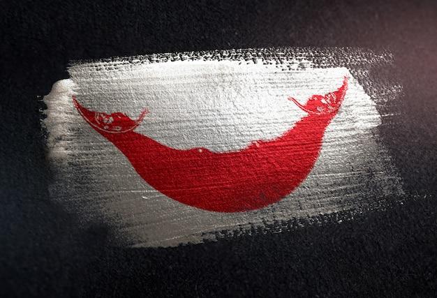 Drapeau de l'île de pâques en peinture à brosse métallique sur mur sombre de grunge