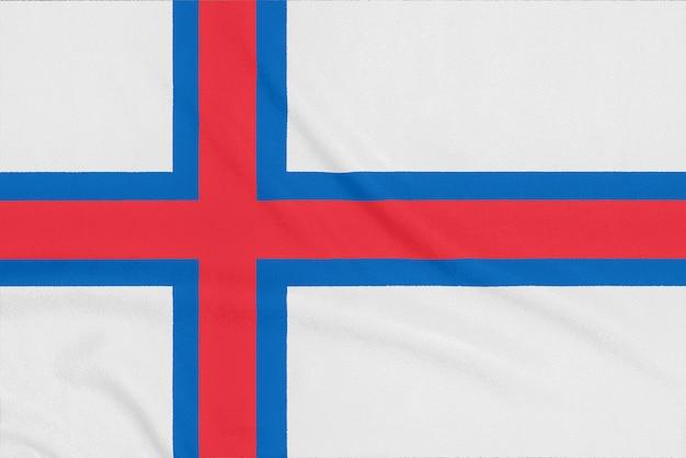 Drapeau des îles féroé sur tissu texturé. symbole patriotique