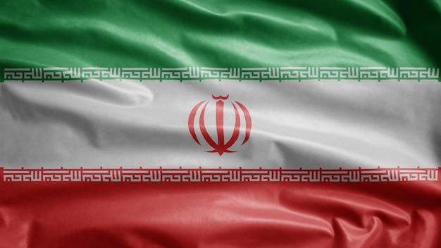 Drapeau iranien flottant dans le vent. gros plan de la bannière de l'iran soufflant de la soie lisse