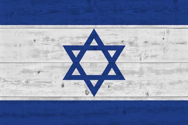 Drapeau d'israël peint sur une vieille planche de bois