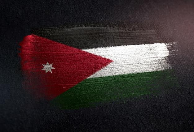 Drapeau de la jordanie faite de peinture brosse métallique sur grunge dark wall