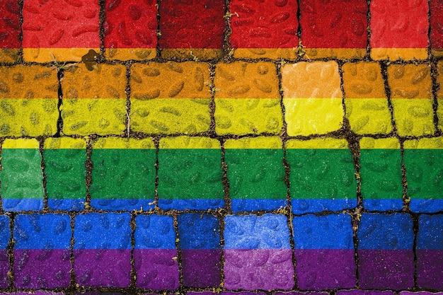 Drapeau des lgbt sur fond de mur de pierre bannière de drapeau sur fond de texture de pierre