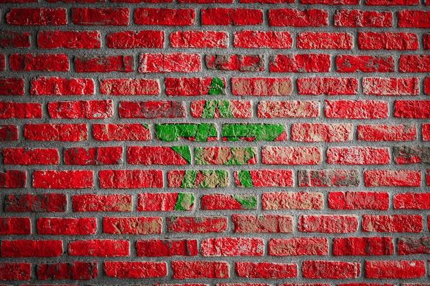 Drapeau national du maroc sur un vieux mur de briques