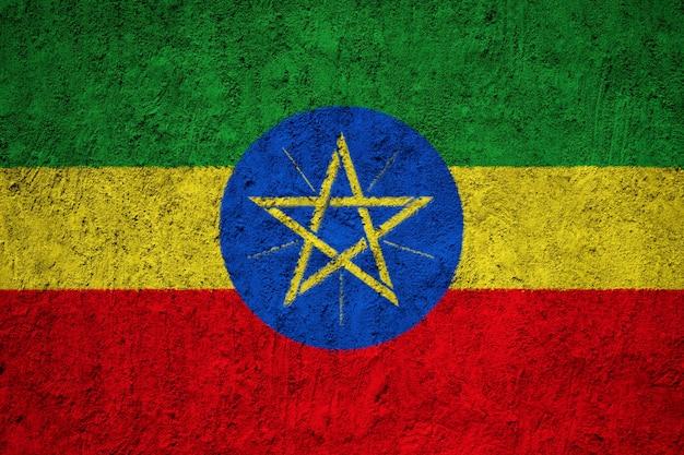 Drapeau national éthiopien peint sur un mur de béton