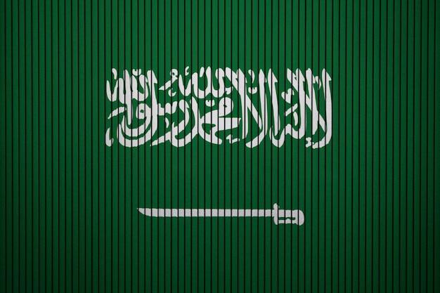 Drapeau national peint de l'arabie saoudite sur un mur de béton