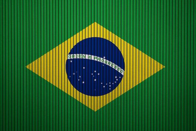 Drapeau national peint du brésil sur un mur de béton