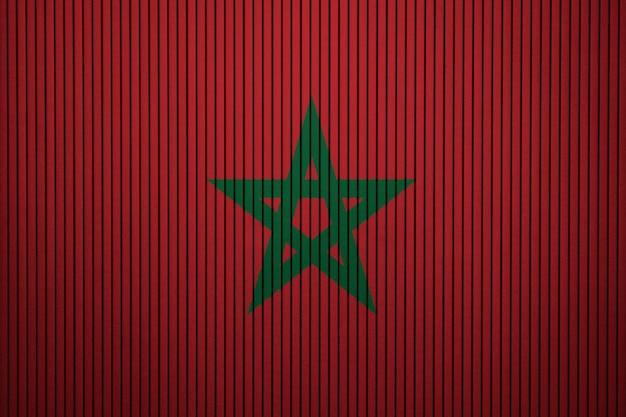 Drapeau national peint du maroc sur un mur de béton