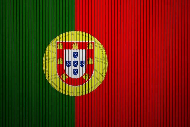 Drapeau national peint du portugal sur un mur de béton