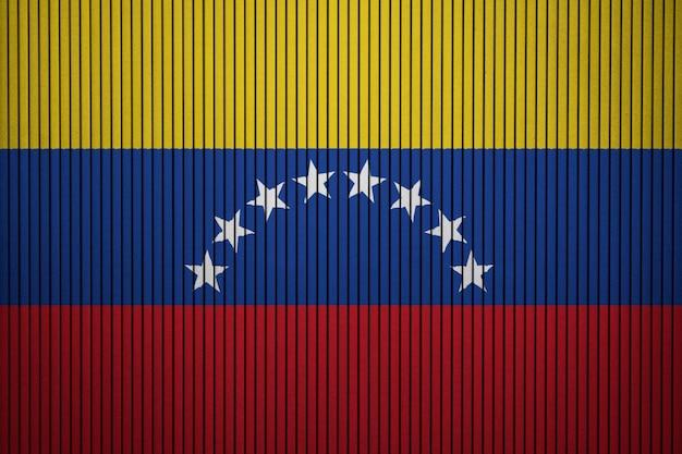 Drapeau national peint du venezuela sur un mur de béton
