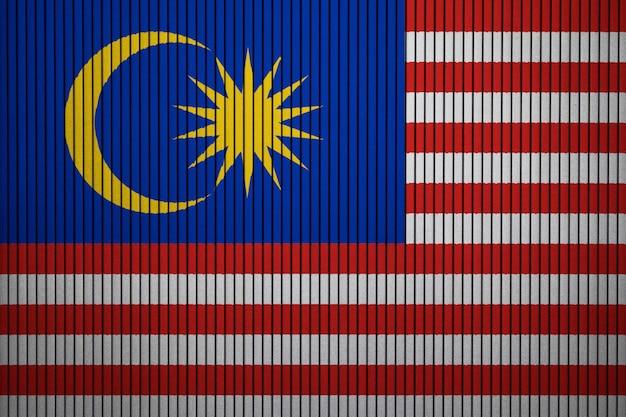 Drapeau national peint de malaisie sur un mur de béton