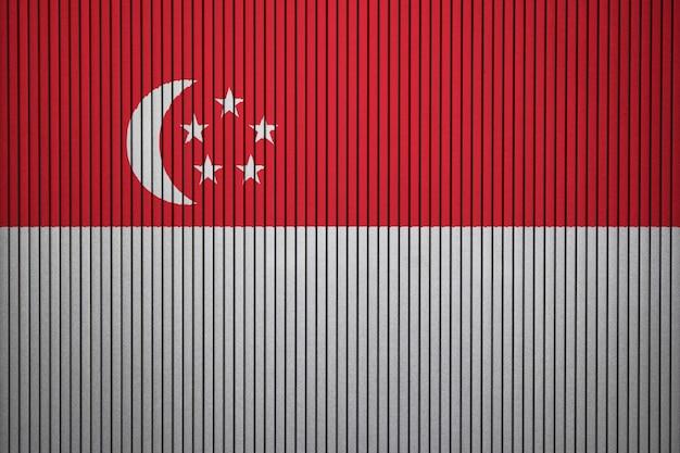 Drapeau national peint de singapour sur un mur de béton