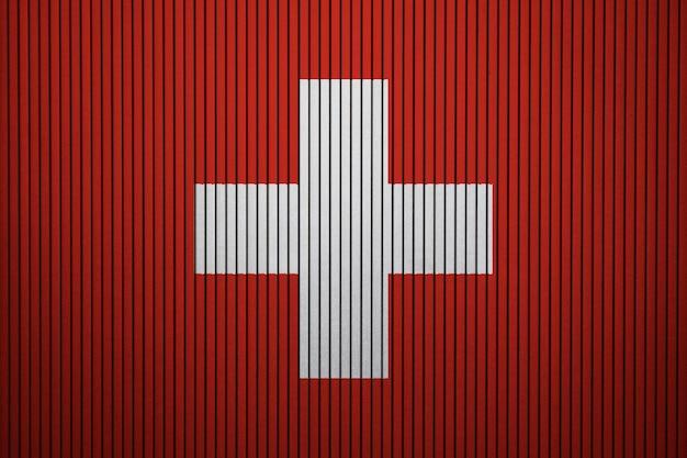 Drapeau national peint de la suisse sur un mur de béton