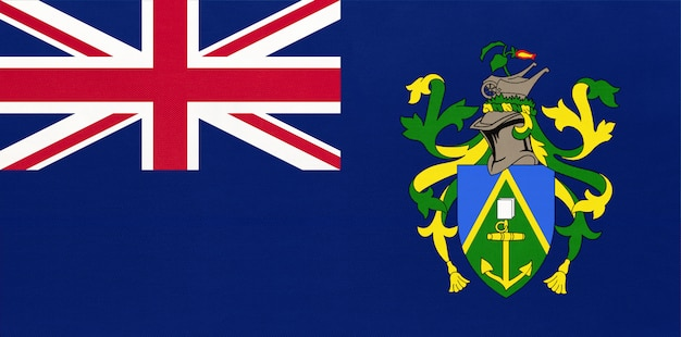 Drapeau national de tissu des îles pitcairn, fond textile. symbole des territoires britanniques internationaux d'outre-mer.