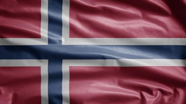 Drapeau norvégien dans le vent. gros plan du modèle de la norvège soufflant, soie douce et lisse. fond de bannière de texture de tissu de tissu