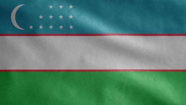 Drapeau de l'ouzbékistan dans le vent. modèle ouzbek soufflant, soie douce et lisse. fond d'enseigne de texture de tissu de tissu. utilisez-le pour le concept d'occasions nationales et nationales.