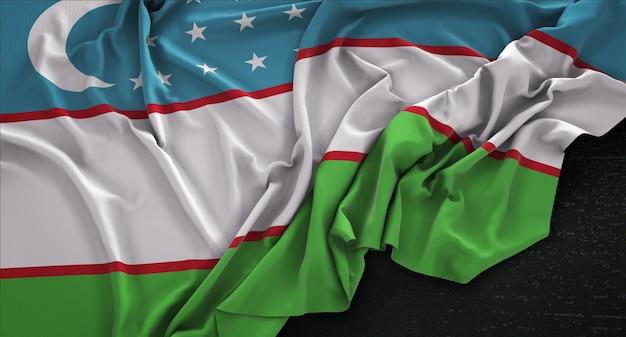 Drapeau de l'ouzbékistan enroulé sur fond sombre 3d render
