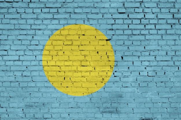 Le drapeau des palaos est peint sur un vieux mur de briques