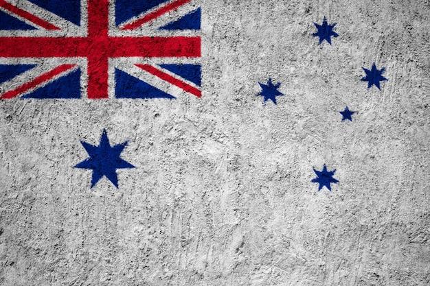 Drapeau peint du pavillon naval d'australie sur un mur de béton