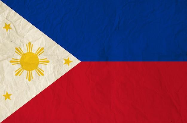 Drapeau des philippines avec du vieux papier vintage