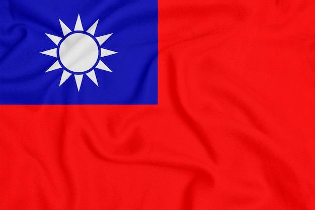 Drapeau de la république de chine sur tissu texturé. symbole patriotique