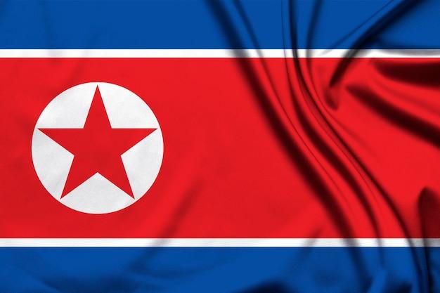 Drapeau de la république démocratique populaire coréenne comme toile de fond
