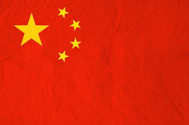 Drapeau de la république populaire de chine avec du vieux papier vintage