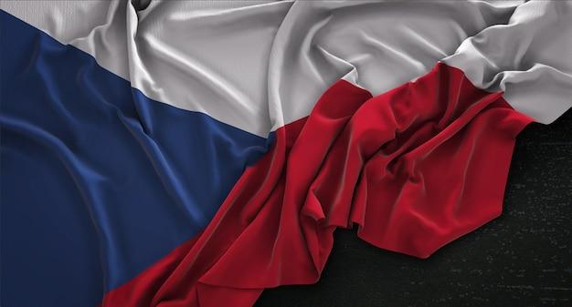 Drapeau de la république tchèque enroulé sur fond sombre 3d render