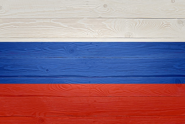 Drapeau de la russie peint sur fond de planche de bois ancien